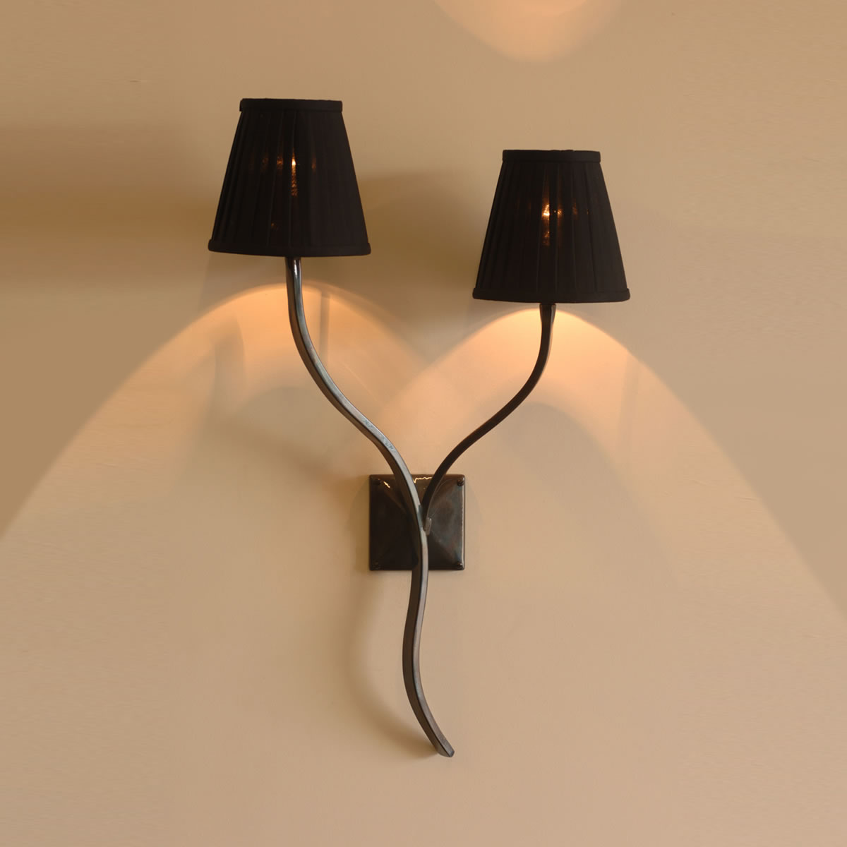 The Ailsworth Twin Candle Wrought Iron Wall Light