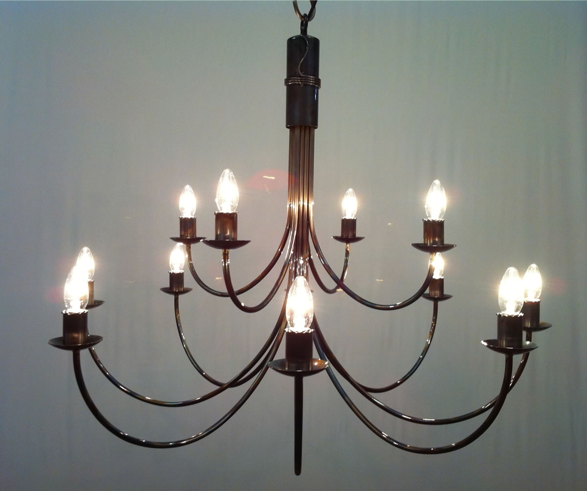 The belton 2 tiered 12 arm wrought iron candle chandelier